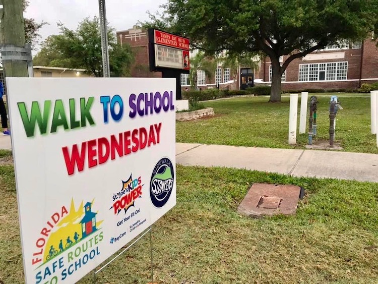 Signage outside Tampa Bay Boulevard Elementary recognizing Walk to School Wednesdays.