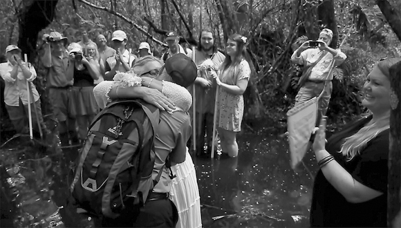 Mike Owen and Donna Glann-Smyth marry near a ghost orchid-bearing tree in the Fakahatchee Preserve State Park.
