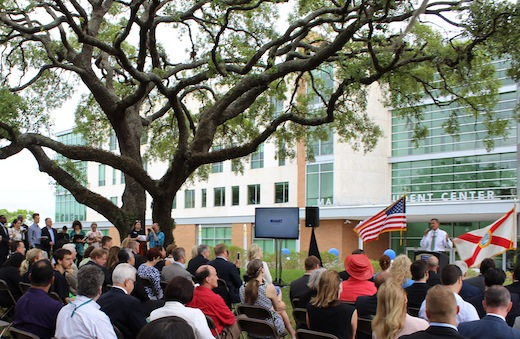 Crowd awaits unveiling of electric vehicles at USF