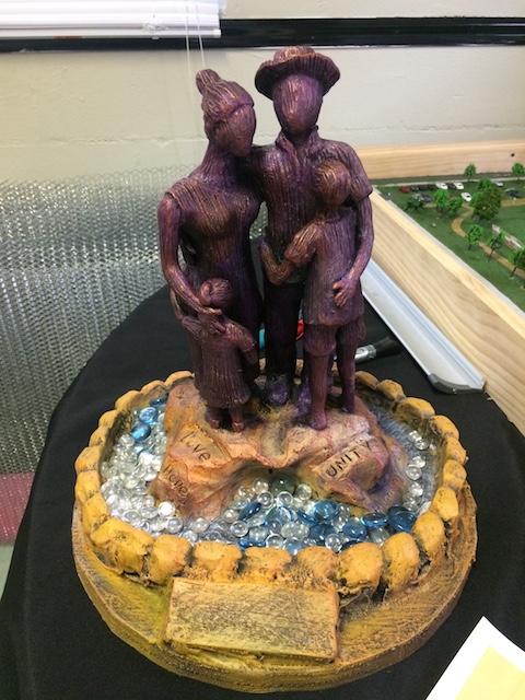 "A model of ""Family,"" the 14-foot statue built at Harvest Hope Park in North Tampa."
