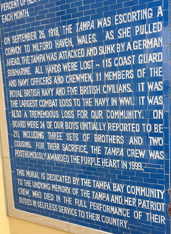 Glass mural tells the history of USS Tampa.