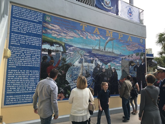 A crowd of visitors explores mural details at Tampa Bay History Center.