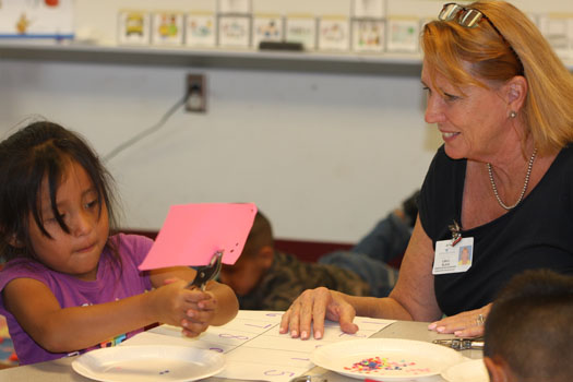 Kindergarten supervisor Lisa Black works with a VPK student.